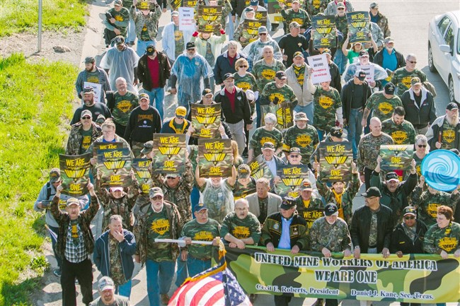 Thousands of mine workers and supporters march down E. Roy Furman highway in Waynesburg for a rally by the United Mine Workers of America in April.