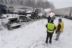 Multiple vehicles are piled up after an accident near mile marker 13 along the westbound lanes of Interstate 90, Thursday in Girard, Pa.