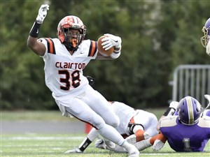 Clairton's Lamont Wade carries against Bishop Guilfoyle in the PIAA Class A championship Friday at Hersheypark Stadium.