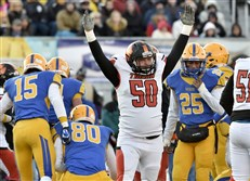 Beaver Falls' Mark Wildes signals a touchdown as his team scores against Middletown in the first quarter in the PIAA Class 3A championship Saturday at Hersheypark Stadium.