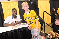 Andrew McCutchen poses for a photo with 9-year-old fan Parker Cunningham, of South Park, Saturday at PirateFest at the David L. Lawrence Convention Center.