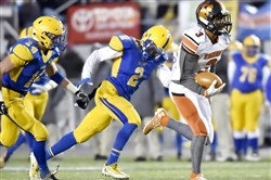 The WPIAL board of directors had a hearing Tuesday with longtime Aliquippa assistant Sherman McBride over a charge that he recruited Malik Shepherd, above with ball, to transfer from Beaver Falls to Aliquippa in April.
