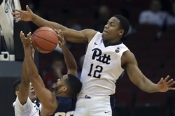 Panthers' Chris Jones blocks a shot by Penn State's Shep Garner during the first half Saturday.