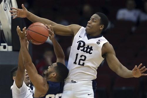 Panthers' Chris Jones blocks a shot by Penn State's Shep Garner during the first half Saturday.