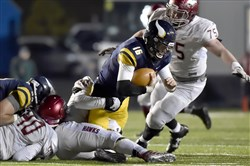 Central Catholic quarterback Troy Fisher is sacked by St. Joseph Prep's Rayshad Wallace in the PIAA Class 6A championship Saturday at Hersheypark Stadium.