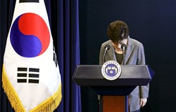 In this Nov. 29 file photo, South Korean President Park Geun-hye bows during her address to the nation while saying she'll resign if parliament comes up with a plan for the safe transfer of power, at the presidential Blue House in Seoul.