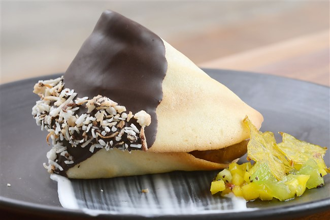 Executive pastry chef Heidi Zerbe makes giant fortune cookies filled with mousse, one of the items on the dessert menu at Social House Seven, Downtown.