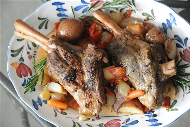 Braised lamb shanks with pearl onions and new potatoes.