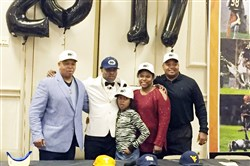 Lamont Wade announces that he will attend Penn State in 2017. From left to right, he's joined by his father, sister, mother and cousin Wayne Wade, also Clairton's head coach.