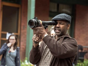 "Denzel Washington on the set of ""Fences,"" filming in the Hill District last year."