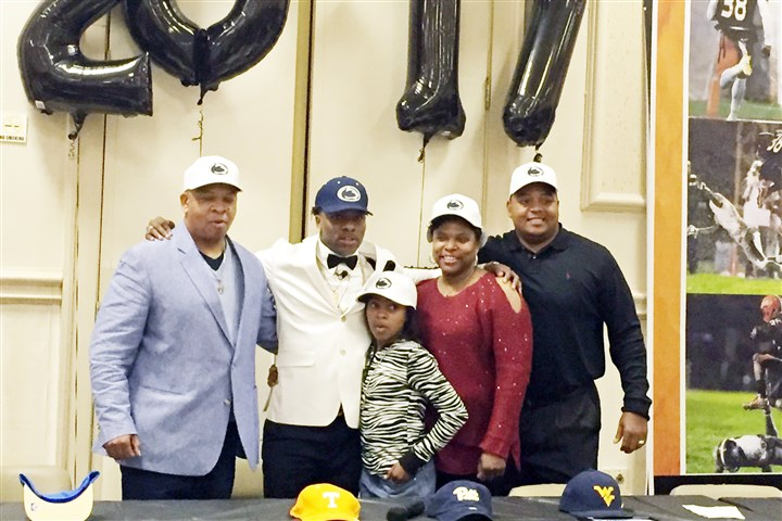 Lamont1218a Lamont Wade announces that he will attend Penn State in 2017. From left to right, he's joined by his father, sister, mother and cousin Wayne Wade, also Clairton's head coach.