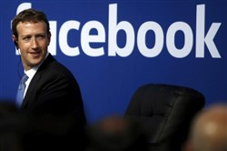 Facebook CEO Mark Zuckerberg is seen on stage during a town hall at Facebook's headquarters in Menlo Park, Calif.