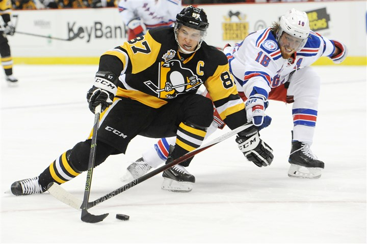 20161220rldPenVsRangers02-1 The Penguins' Sidney Crosby skates around the Rangers' Marc Staal during a game on Dec. 20 at PPG Paints Arena.