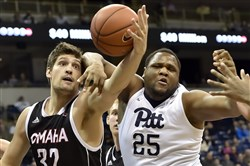 Pitt's Rozelle Nix reaches for a rebound against Omaha's Daniel Meyer in a game earlier this season.