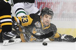 Penguins winger Conor Sheary battles for a loose puck along the boards Dec. 1 against the Stars.