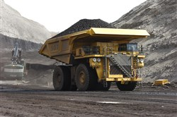 In this April 4, 2013, file photo, a mining dumper truck hauls coal at Cloud Peak Energy's Spring Creek strip mine near Decker, Mont. Renewable energy developers say they're hopeful about the future despite President-elect Donald Trump's promise to bring coal mining jobs back. In recent years, huge solar and wind farms have sprouted up on public desert land in the Western United States buoyed by generous federal tax credits.