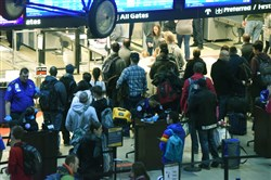 Travelers wait to go through Security on the Landside Terminal of Pittsburgh International Airport.