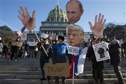 Protesters demonstrate ahead of Pennsylvania's 58th Electoral College at the state Capitol in Harrisburg.
