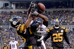 Steelers Mike Mitchell breaks up a pass in the end zone against the Ravens' Breshad Perriman in the first quarter Sunday at Heinz Field.