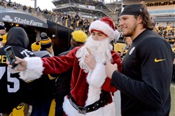 Steelers linebacker Anthony Chickillo poses with a fan before the Steelers face the Ravens on Christmas Day at Heinz Field.