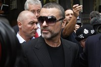 In this Aug. 24, 2010, file photo, British singer George Michael leaves Highbury Corner Magistrates Court in north London. Michael pleaded guilty in a London court to two drug offenses.