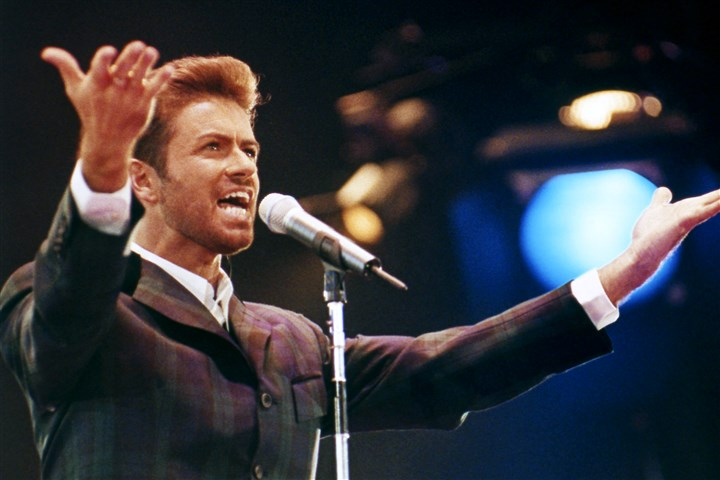 "George Michael Obit In this Dec. 2, 1993 file photo, George Michael performs at ""Concert of Hope"" to mark World AIDS Day at London's Wembley Arena. According to a publicist on Sunday, Dec. 25, 2016, the singer has died at the age of 53."