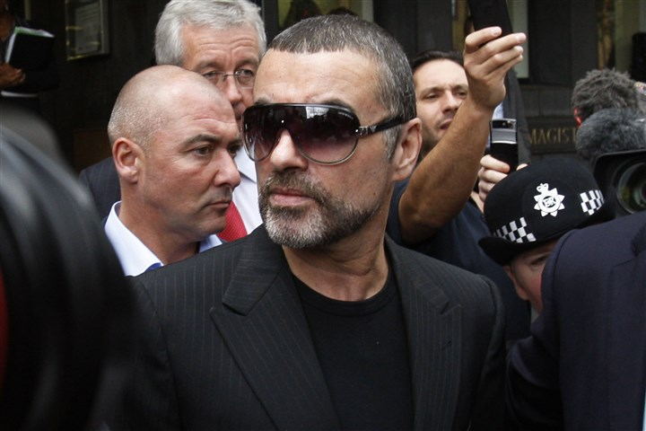 George Michael Obit-6 In this Aug. 24, 2010, file photo, British singer George Michael leaves Highbury Corner Magistrates Court in north London. Michael pleaded guilty in a London court to two drug offenses.