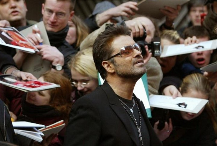 george michael British singer George Michael leaves a news conference for the film 'George Michael - A Different Story' in Berlin in 2005.