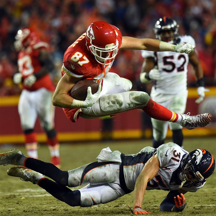WEB Travis Kelce 122616 Chiefs tight end Travis Kelce leaps over Broncos free safety Justin Simmons during Sunday's game at Arrowhead Stadium.