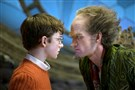 "Louis Hynes, left, and Neil Patrick Harris star in the Netflix series ""A Series of Unfortunate Events."""
