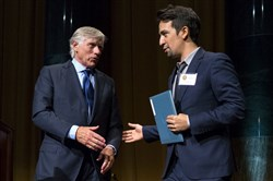 "Columbia University President Lee Bollinger, left, reaches out to Lin-Manuel Miranda, who was recognized for the Pulitzer Prize in Drama for ""Hamilton,"" during the Pulitzer Prize awards at Columbia University in New York."