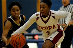 Serra's Aaliyah Coleman races downcourt past Steel Valley's Tamarrow Thomas during their game in the East Allegheny Holiday Tournament Wednesday.