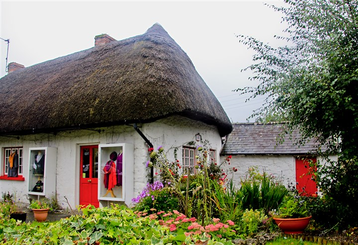 IrelandSheridan10 Many of the thatched-roof cottages in the village of Adare have been turned into shops or restaurants.