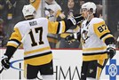 Sidney Crosby, right, has 26 goals this season. Bryan Rust, left, has 10.