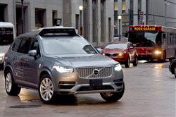 One of Uber's autonomous Volvos makes a turn onto 7th Avenue from Grant Street, Downtown.