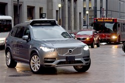 One of Uber's self-driving Volvos turns Downtown.