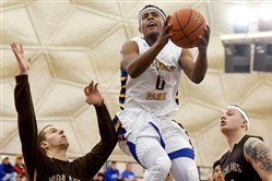 Lincoln Park's Nelly Cummings (0), in a game earlier this season, had 35 points Thursday night against Seton-LaSalle.