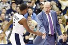 Pitt head coach Kevin Stallings congratulates Justice Kithcart on a play Dec. 31 against Notre Dame.