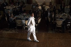Curtis Aiken Jr. walks across the floor as he is presented at the Pittsburgh Chapter of Jack and Jill of America, Inc.Õs 18th Biennial Presentation Ball at the Omni William Penn Hotel downtown on Dec 30, 2016. (Haley Nelson/Post-Gazette)