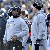 Steelers head coach Mike Tomlin talks with quarterback Ben Roethlisberger as they take on the Browns in the first quarter Sunday at Heinz Field. Roethlisberger sat out the game because the team had already clinched its playoff spot.