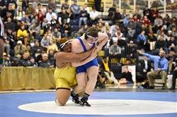 Canon-McMillan's Brendan Furman (blue singlet) pinned Ronald Tucker of Lockport, Ill., in the 285-pound final in the Powerade Christmas Tournament.