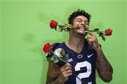 Penn State safety Marcus Allen hams it up while getting his photo taken during media day for the Rose Bowl Friday in Los Angeles.