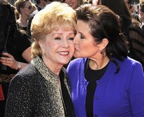Debbie Reynolds, left, and Carrie Fisher arrive at the Primetime Creative Arts Emmy Awards in Los Angeles in 2011. Their deaths last week occurred a day apart.