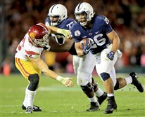 Penn State running back Saquon Barkley runs with the ball in the second half against the USC Trojans during the Rose Bowl Monday night in Pasadena, Calif.