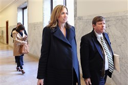 Michelle Stepnick arrives at a court hearing wth attorney Craig Alexander on Jan. 4.