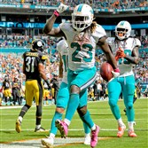 Jay Ajayi celebrates as he scores a touchdown against the Steelers in a game at Hard Rock Stadium in October.