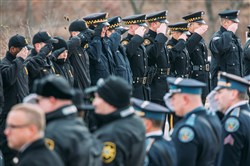 Police officers line the procession route at the Blair County Convention Center for the funeral of 23-year-old state Trooper Landon Weaver on Thursday.