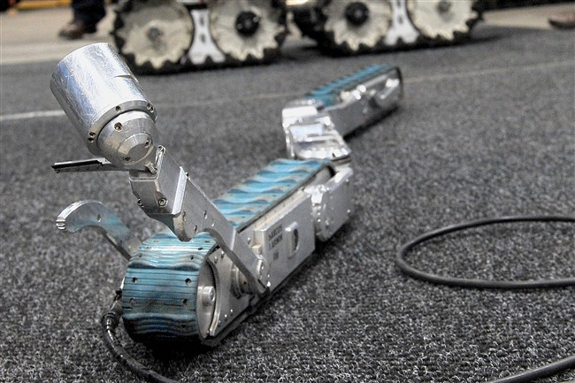 The snake robot fits into a 4-inch-wide bore hole to gather information needed in a mine rescue.