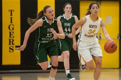North Allegheny's Hailey Zeise dribbles down court as Pine Richland's Amanda Kalin, left, and Anna Jurkovec, back, run after her during a game at North Allegheny High School on Thursday. Pine-Richland won the battle of unbeatens.