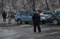Law enforcement officials patrol the parking lot of the Monroeville Mall by Macy's on Friday.
